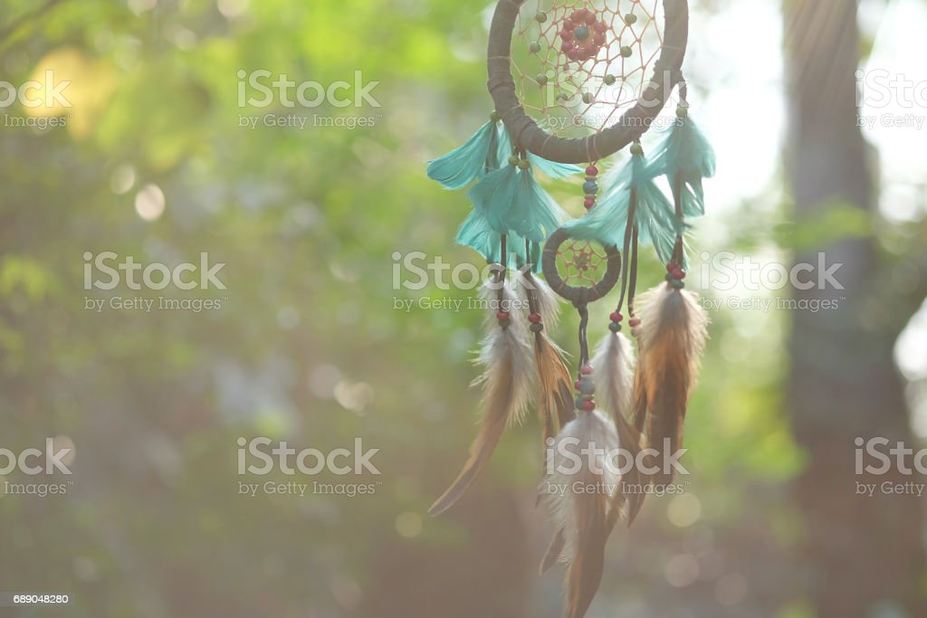 Soft focus dream catcher blue coral and natural bokeh background selective focus and blurry. (Vintage style) boho chic, ethnic amulet. stock photo