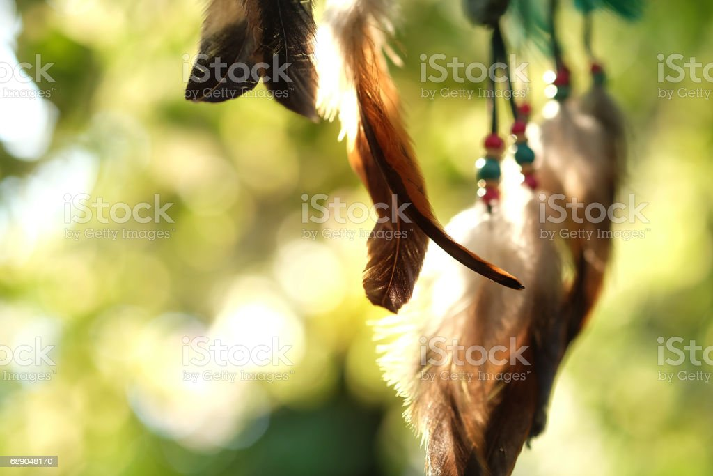 Soft focus dream catcher with natural bokeh background selective focus and blurry. Native american dream catcher. boho chic, ethnic amulet. stock photo