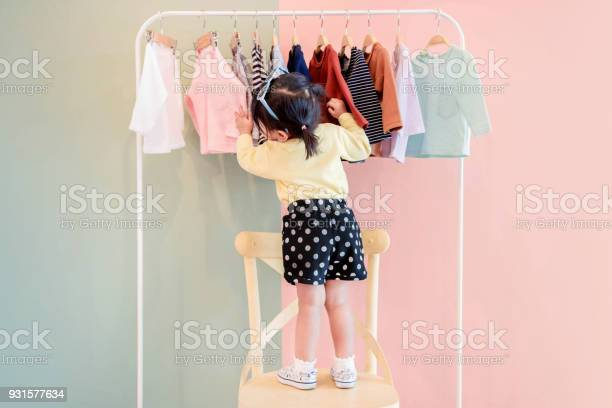 Soft focus of a two years old child choosing her own dresses from picture id931577634?b=1&k=6&m=931577634&s=612x612&h=gjqnh14zr5ic3wd980zcam4es8mac53wpy1 k8 cg64=