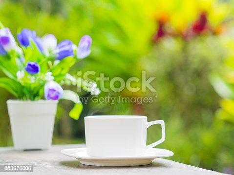 istock Soft focus of close up coffee cup in garden. 853676006