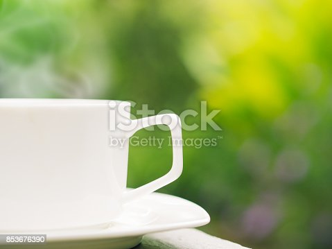 istock Soft focus of close up coffee cup in garden. 853676390