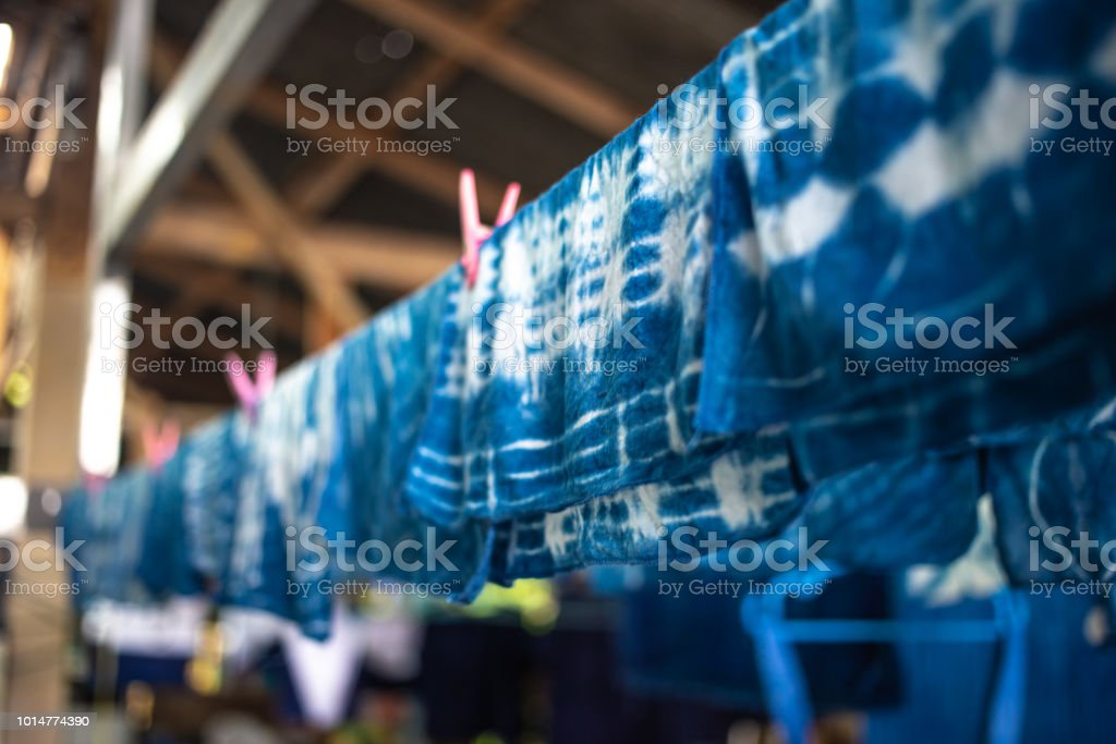 Soft focus of hanging with tie dye, dyed fabric with natural color stock photo