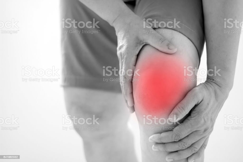 Soft focus of Old Asian women to knee injury on white background,black and white tone stock photo