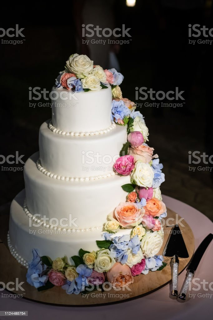 Soft Focus of wedding cake with fresh flowers and black background