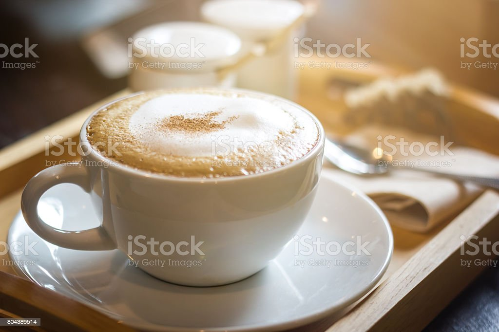 Soft focus on capuccino coffee cup, coffee for background - vintage effect process picture stock photo