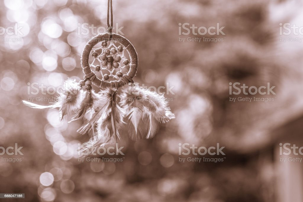 Soft focus on Dream Catcher with natural background in Sepia style. Native american dream catcher. boho chic, ethnic amulet. stock photo