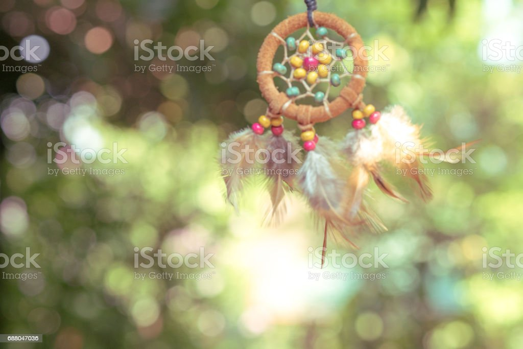 Soft focus on Dream Catcher with natural background in vintage style. Native american dream catcher. boho chic, ethnic amulet. stock photo