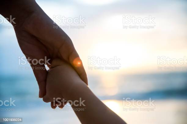 Soft focus parent hold the little child hand during sunset warm tone picture id1001935224?b=1&k=6&m=1001935224&s=612x612&h=hse5k1w1nfr6szy3ch yox4j0r2qjnb1ycke7bwd3gm=