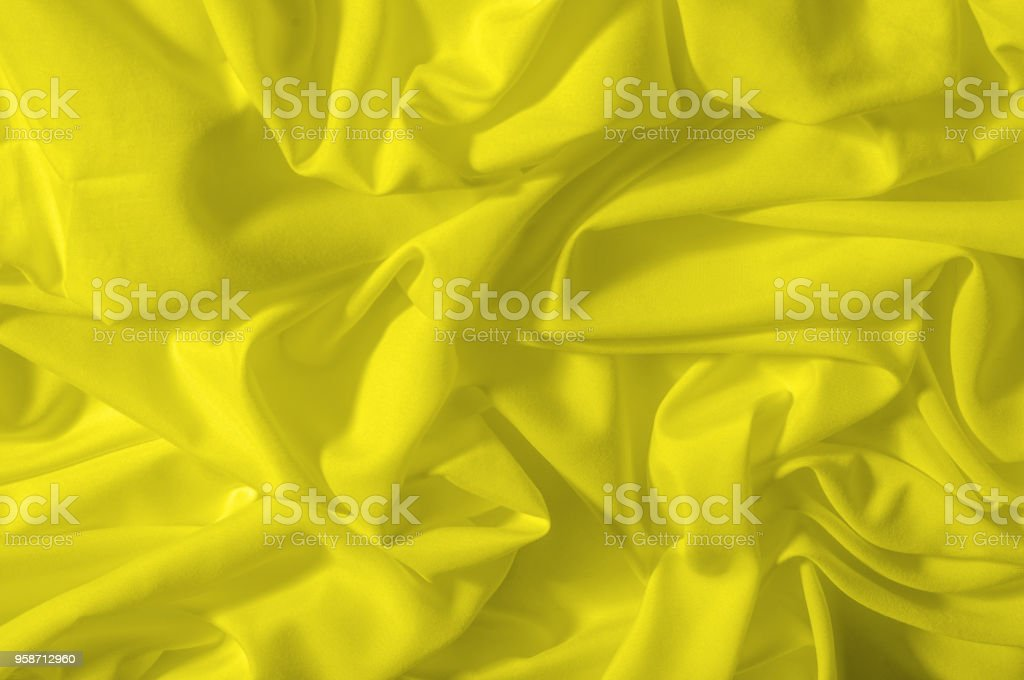 Soft focus. texture, pattern. fabric silky yellow, solar Golden yellow silk feil. Like the body to the taffeta, it has a smooth arm that creates a subtle sheen. Thin and lighter weight, stock photo