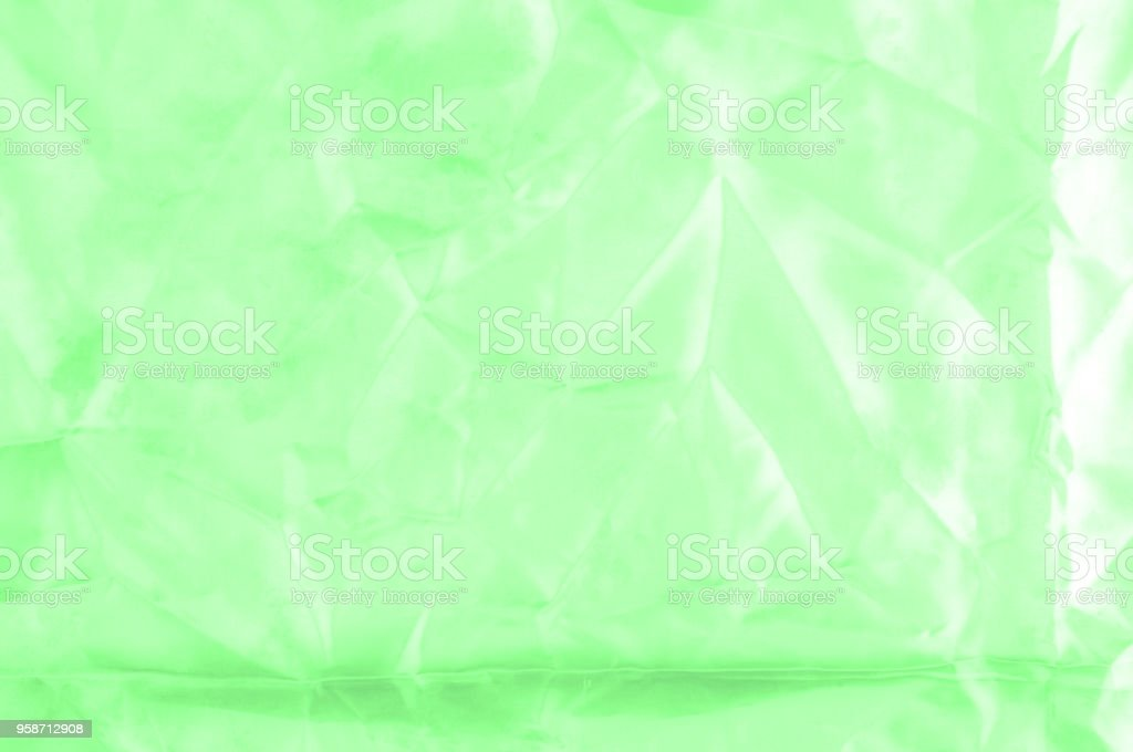 Soft focus. texture, pattern. green silk fabric. Emerald. Update your exquisite design with this Carolina stone green silk feil. it has a smooth hand that creates a subtle sheen. stock photo