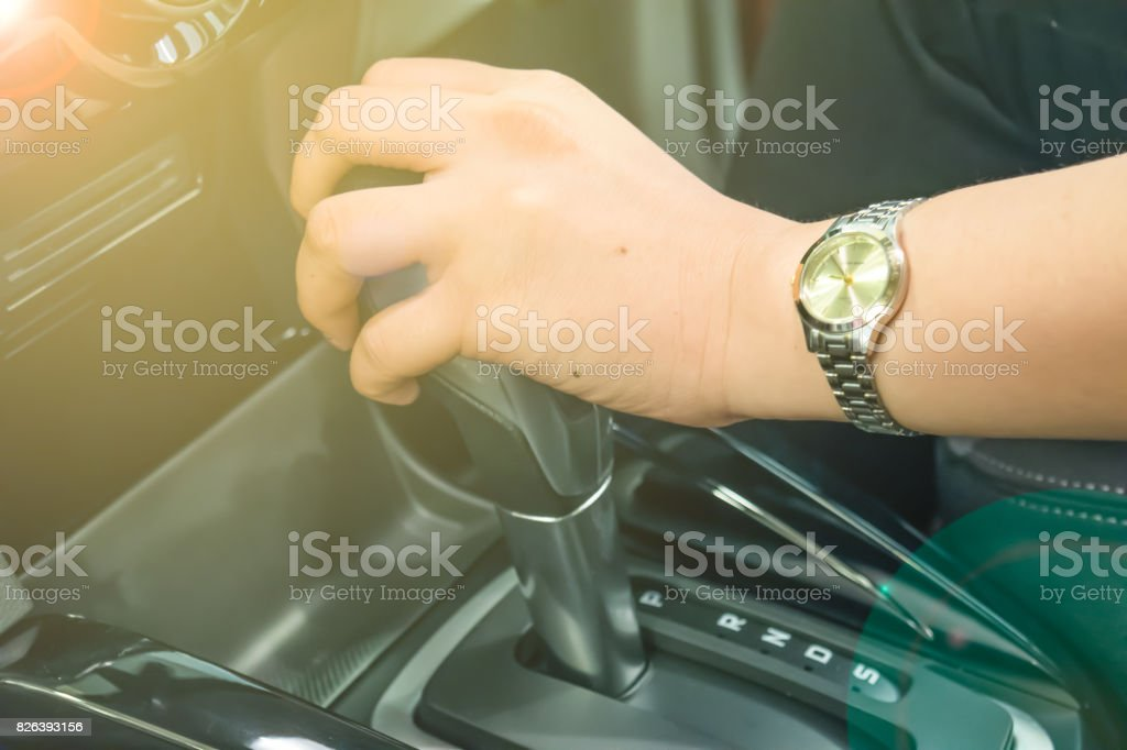 Soft Focus Woman Hand Holding Automatic Gear Shift Transmission