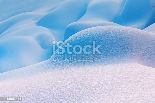 Soft forms of snowdrifts after a heavy snowstorm. Winter and weather concept