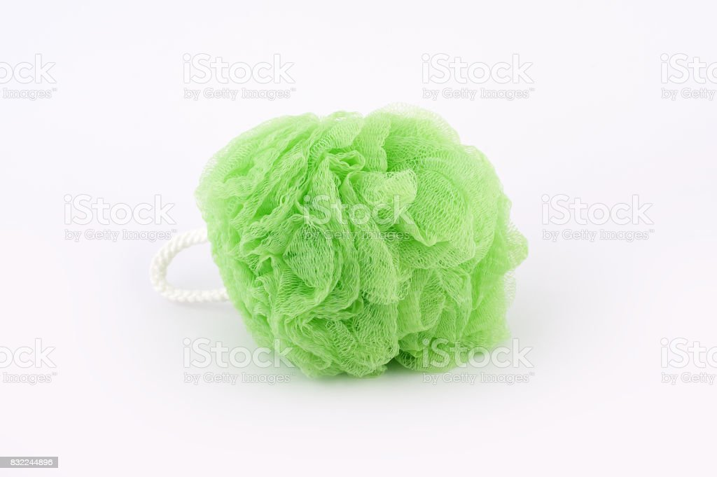 Soft green bath puff or sponge isolated on white background stock photo