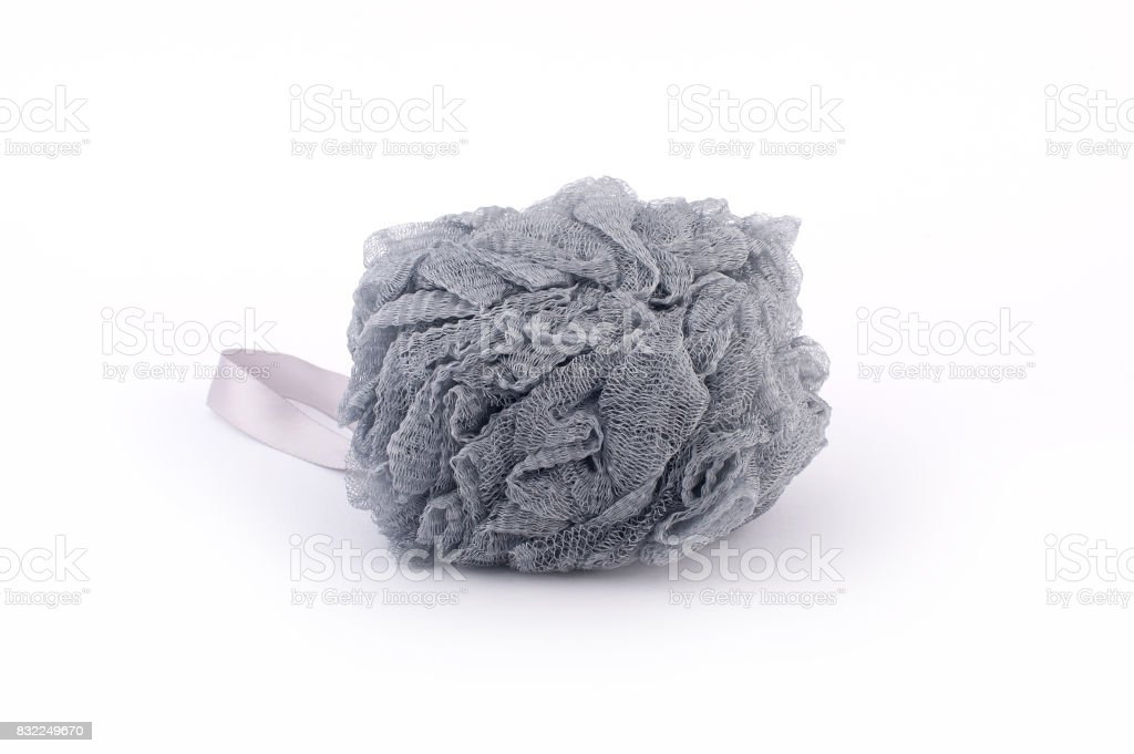 Soft grey bath puff or sponge isolated on white background stock photo
