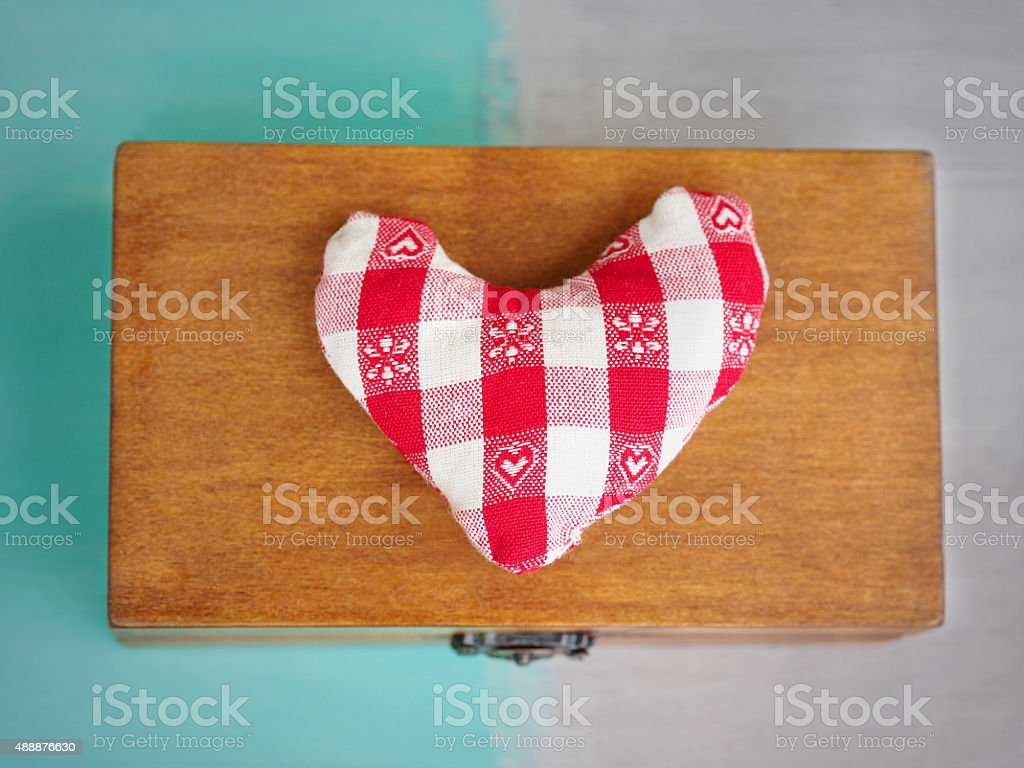 Soft heart on a secret gidt wooden box stock photo