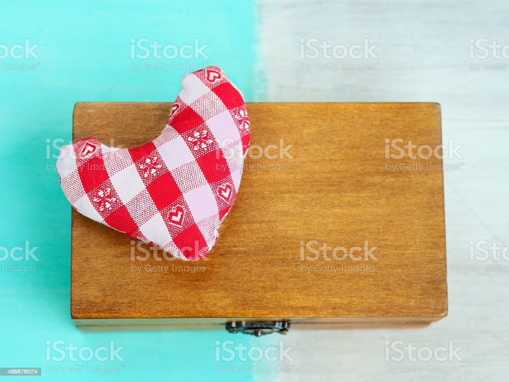 Soft heart on a secret gift wooden box stock photo