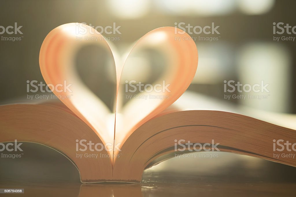 Soft heart shape from paper book page. stock photo