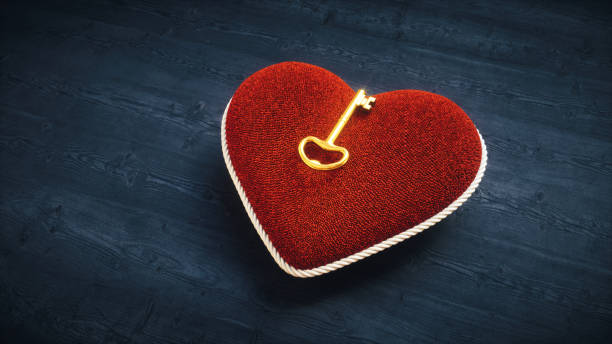 altın anahtar ile yumuşak kalp yastık - sembolizm akımı stok fotoğraflar ve resimler