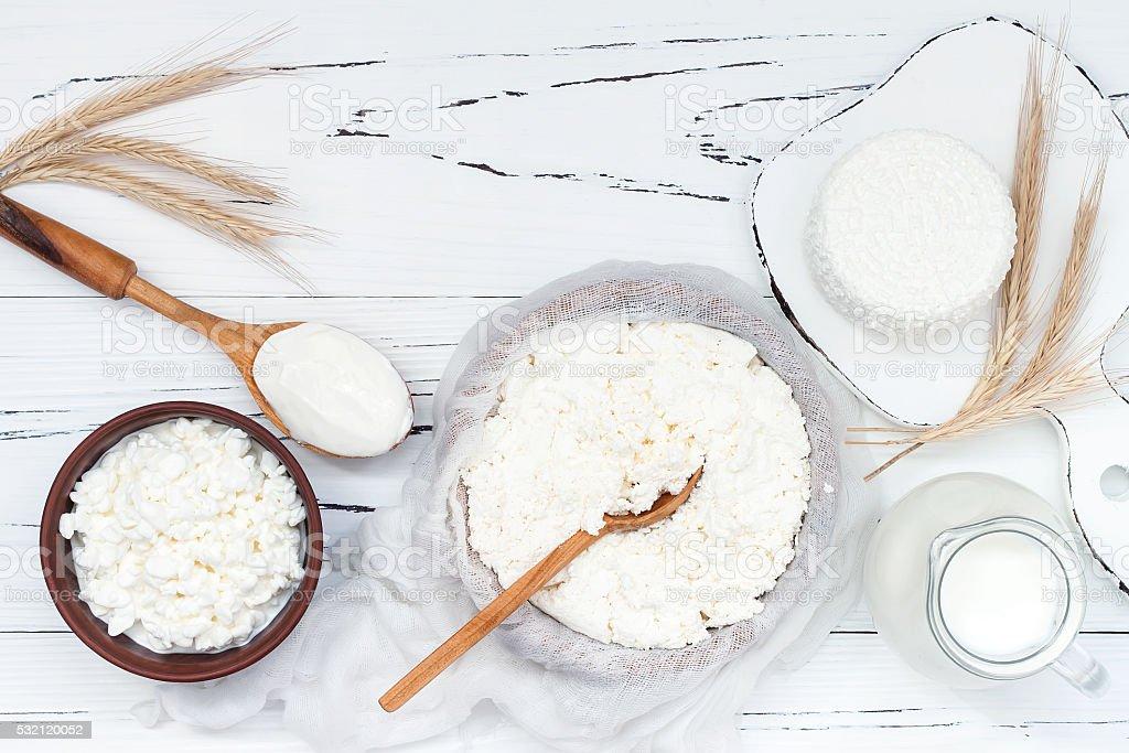 Soft homemade ricotta cottage Tzfat cheese. Judaic holiday Shavuot symbols. stock photo
