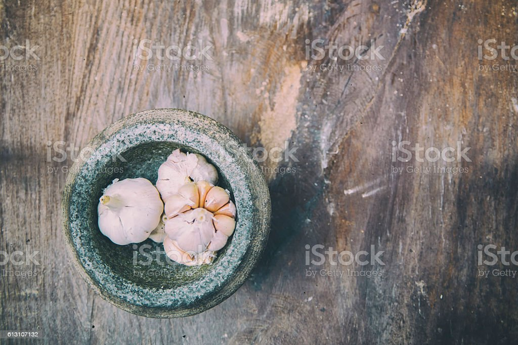 Soft Image of the garlic and stone mortar stock photo
