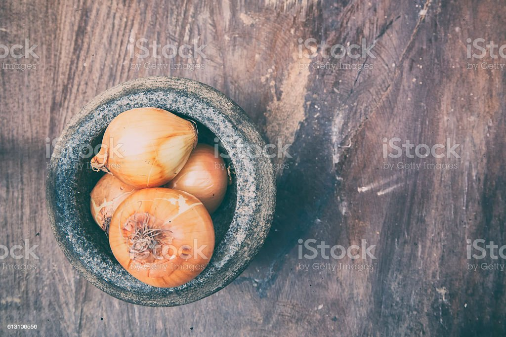 Soft Image of the onions and stone mortar stock photo