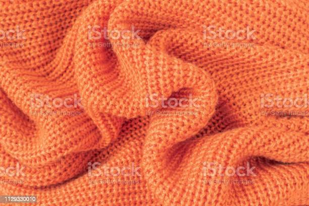 Soft knitted fabric from orange fluffy yarn picture id1129330010?b=1&k=6&m=1129330010&s=612x612&h=6uae07yi bio048vber3tdzve94puaud1it3yja9oz8=