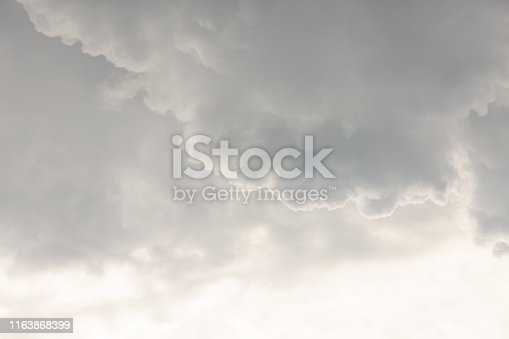 Large heavy white and gray cumulus clouds before a thunderstorm. Close-up