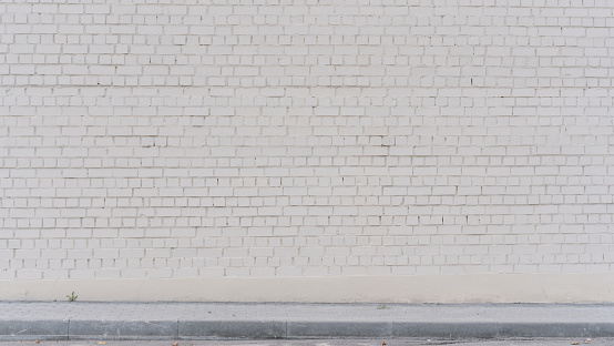 soft light white brick wall facade exterior at city street outdoor front view