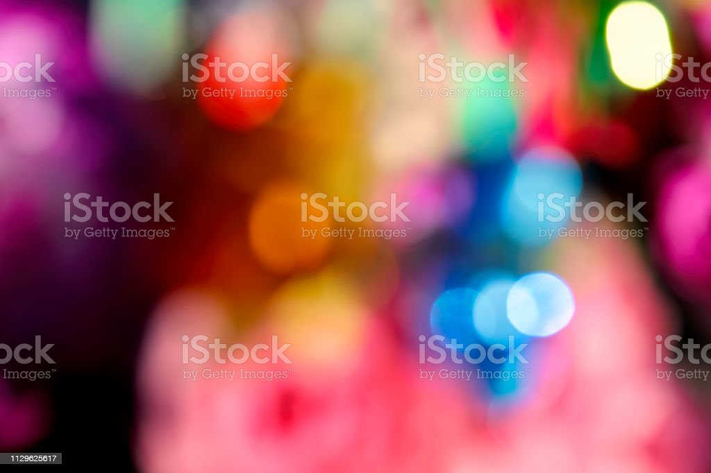 Soft multi-coloured background bokeh lens out of focus circles of confusion stock photo