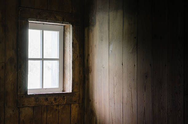 Soft Natural Window Light on Barn Board Interior. stock photo