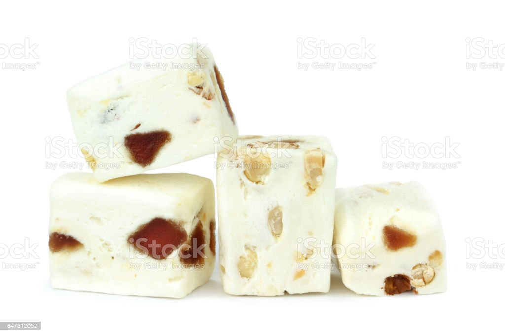 Soft nougat with peanuts and fruits stock photo