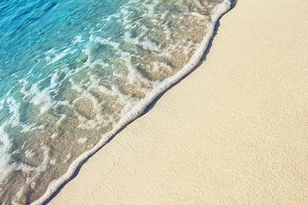 Soft ocean wave on the sandy beach stock photo