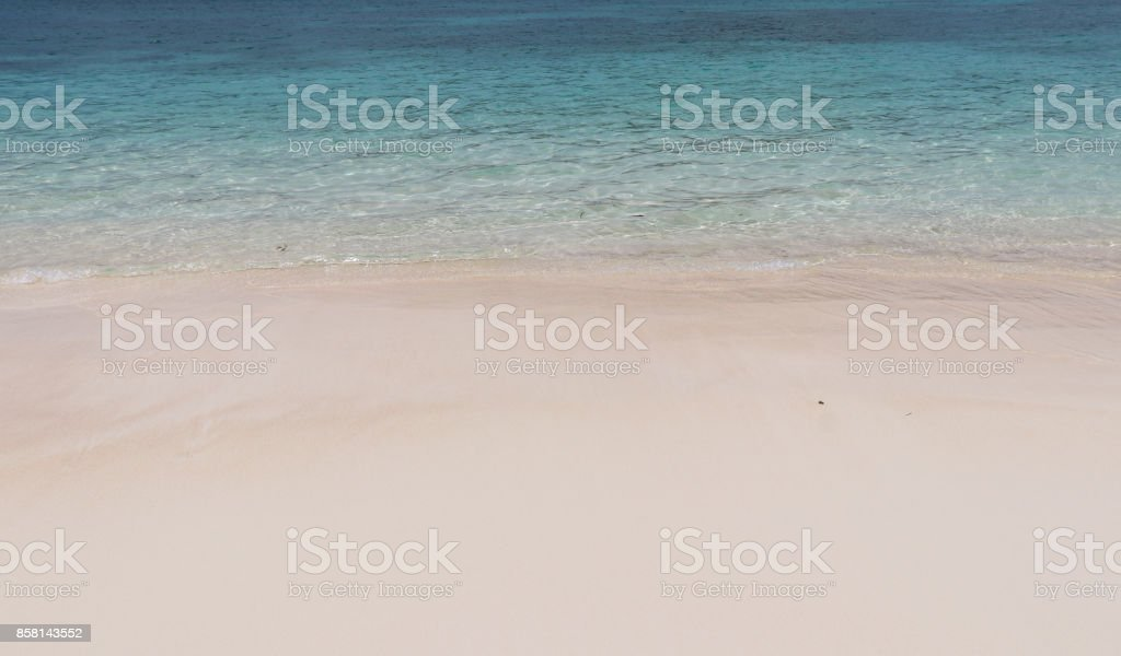 Soft ocean waves on the beach. Background and texture of natural white sandy shore and crystal clean water stock photo