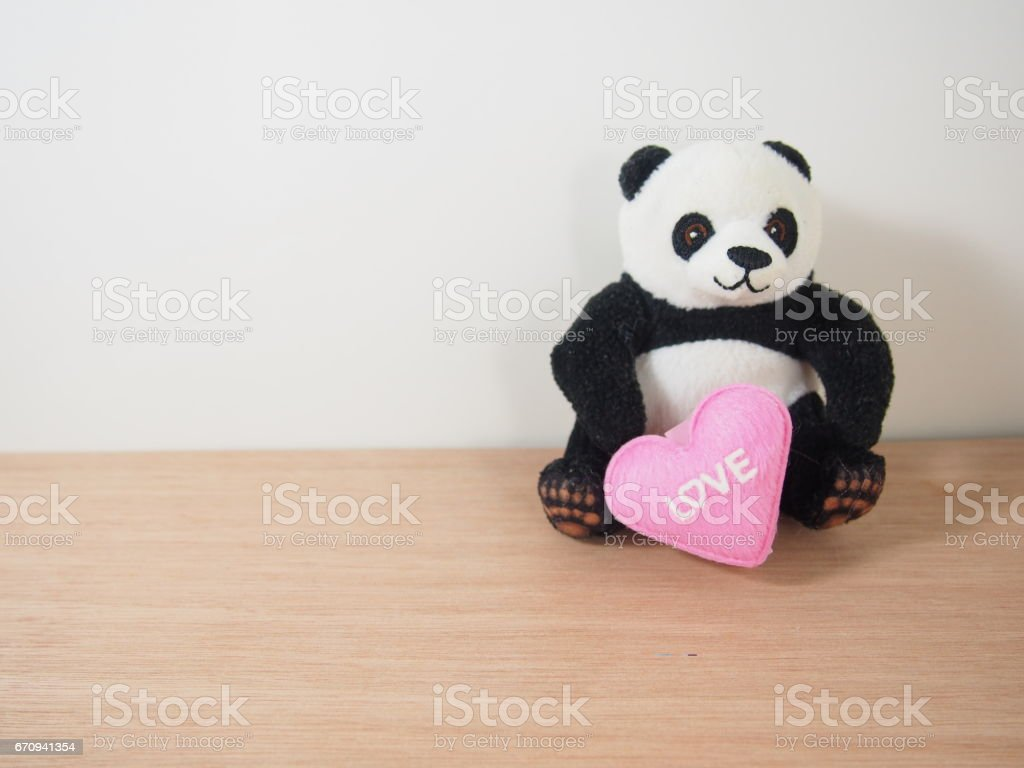Soft panda doll with pink heart shape, love, sweet pillow stock photo
