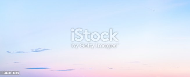istock Soft pastel coloured graduated sky at sunset in winter - panoramic format 646012098
