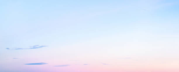 Soft pastel coloured graduated sky at sunset in winter - panoramic format stock photo