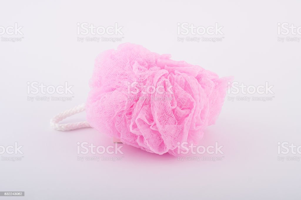 Soft pink bath puff or sponge isolated on white background stock photo