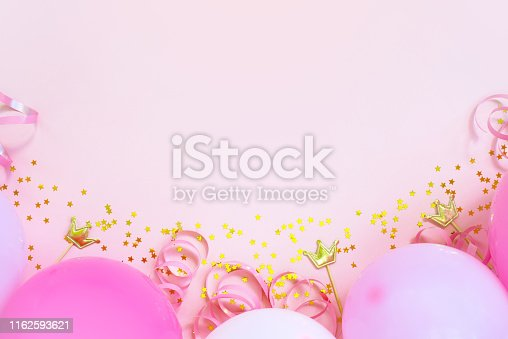 950793576 istock photo Soft pink birthday background with balloons 1162593621