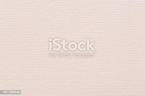 1200909694istockphoto Soft pink textured decoration paper on macro 1021083346