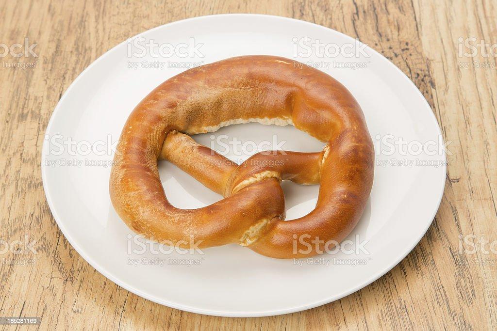 Soft Pretzel on a plate royalty-free stock photo