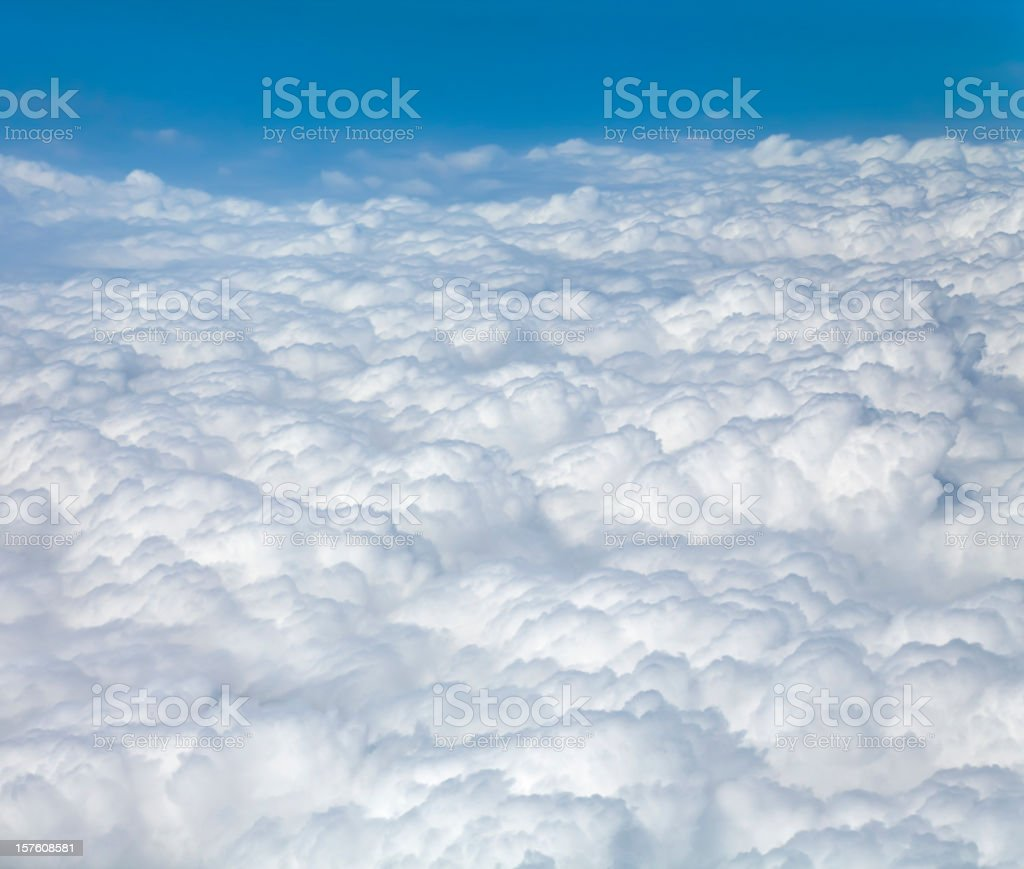 soft puffy cloudscape seen from airplane stock photo