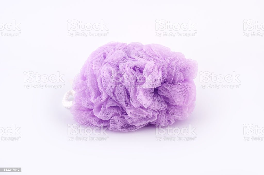 Soft purple bath puff or sponge isolated on white background stock photo