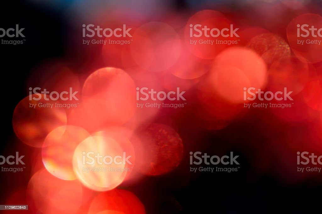Soft red background bokeh lens out of focus circles of confusion stock photo
