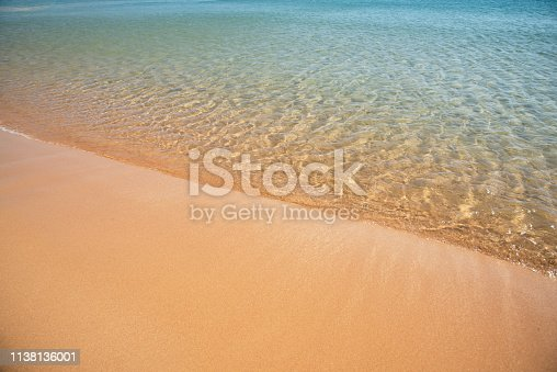 istock Soft sea wave on the sand beach - Summer background 1138136001