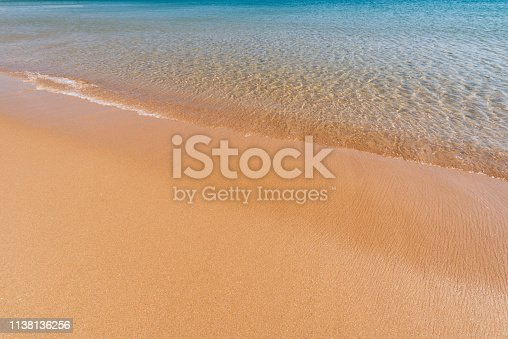 istock Soft sea wave on the sand beach - Summer background 1138136256