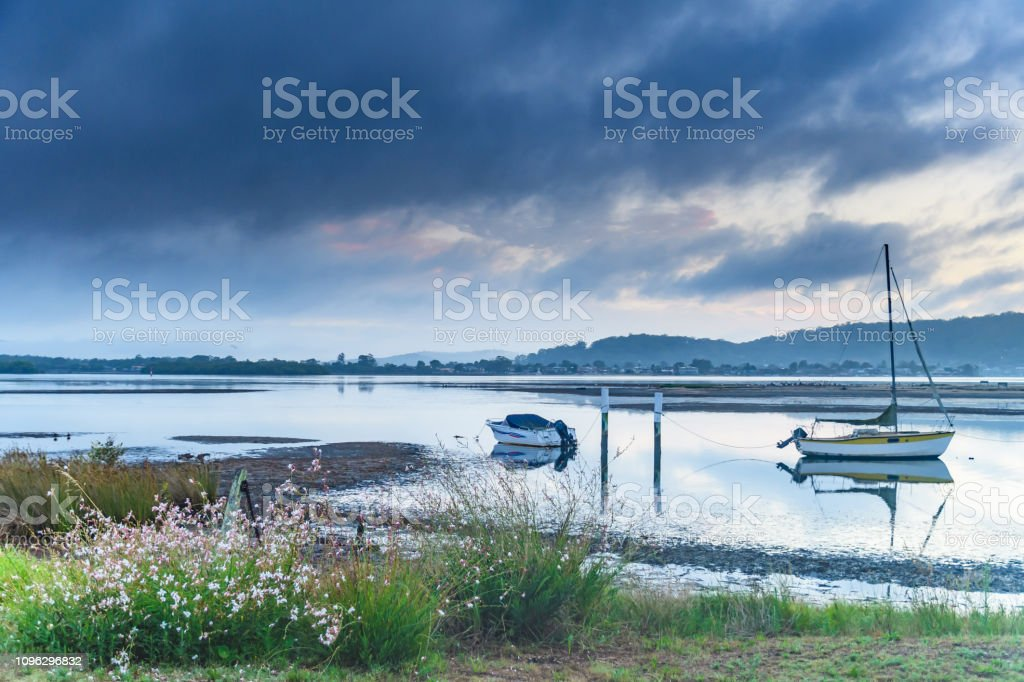 Soft Shades of Blue Sunrise Bay Waterscape stock photo