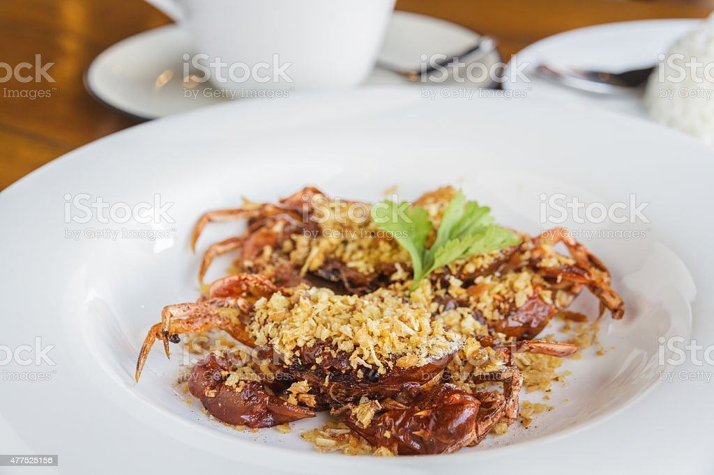 Soft shell crab fried with garlic stock photo