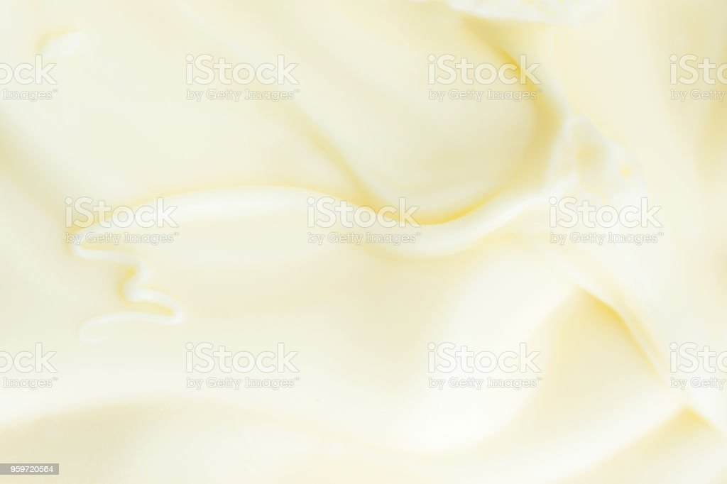 Soft Silky Creamy Butter Texture with Beautiful Swirls. Pastel Light Yellow Color. Food Poster Background. Calories Fats Dairy Organic Produce. Copy Space stock photo