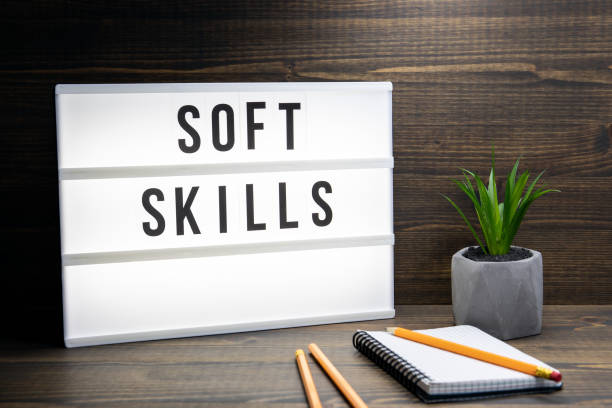 Soft Skills concept. Text in lightbox Soft Skills concept. Text in lightbox. Wooden office table aptitude stock pictures, royalty-free photos & images