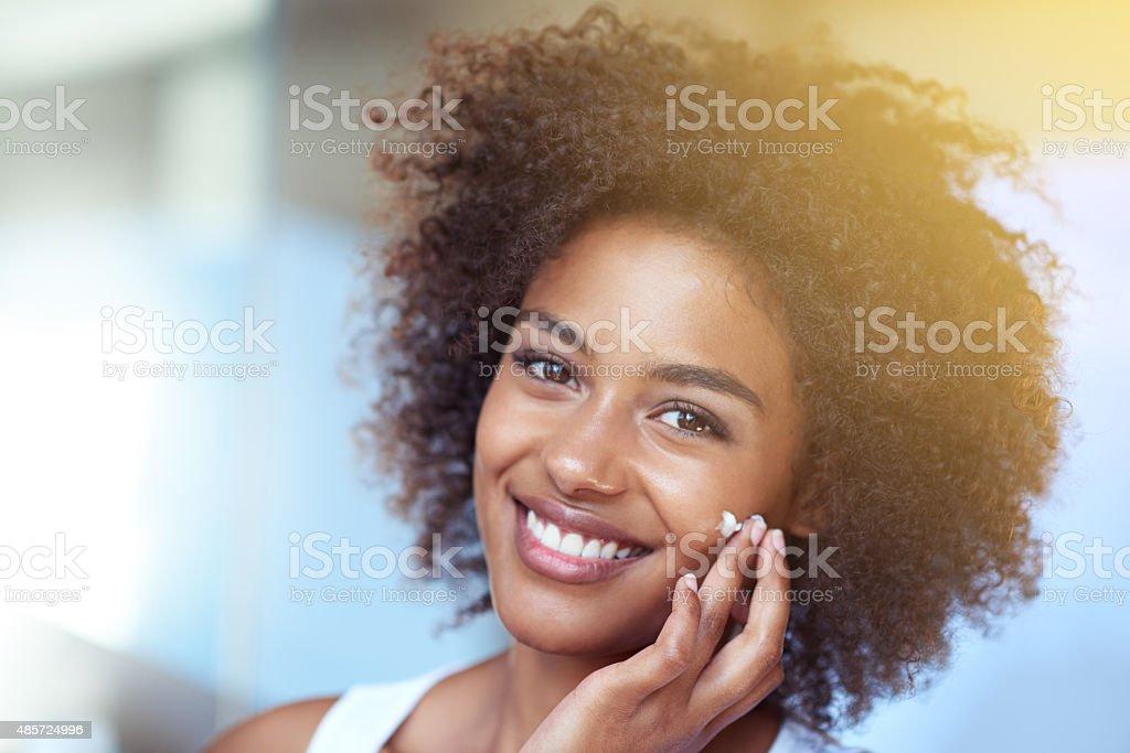 Soft skin keeps me smiling stock photo